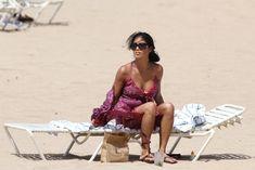 Соблазнительная Николь Шерзингер загорает на пляже в Гонолулу фото #9