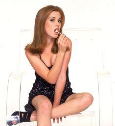 Пикантный образ Айлы Фишер для фотосессии фото #1