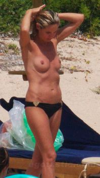 Красотка Хайди Клум топлесс в Сардинии фото #7