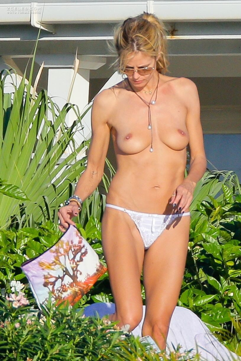 Heidi klum goes topless to show off her curves for new boy toy