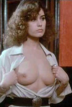 Голая грудь Коринн Клери в фильме Love by Appointment, 1976